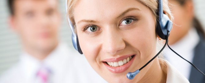Face of young charming confident woman with headset